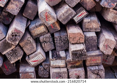 Stacked wood pine timber - stock photo
