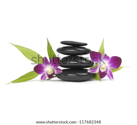 Stacked zen stones with pink orchid and bamboo leaf - stock photo
