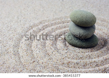 Stacked zen stones with spiral sand