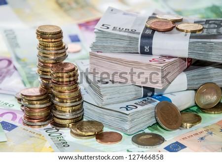 Stackes Coins and Euro Bills (macro shot) - stock photo