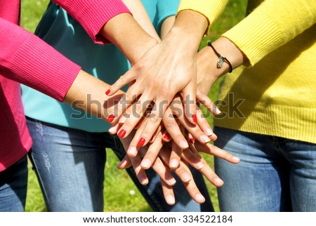 Stacking hands - stock photo