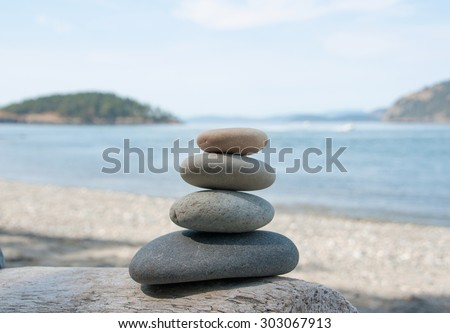 Stacking stones on the wood, different colors stones