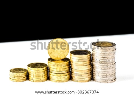 Stacks chart of gold coins isolated on white and black background