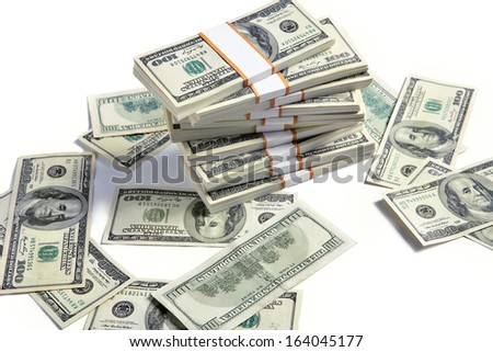 Stacks of american dollars / studio photography of american banknotes of hundred dollar - on white background