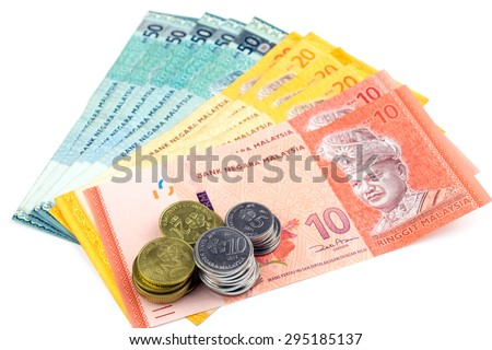 Stacks of banknotes and coins isolated on white background