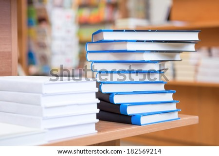 Stacks of books in the bookstore - stock photo