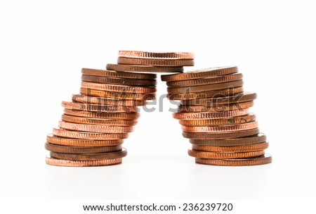 Stacks of brass coins isolated on white