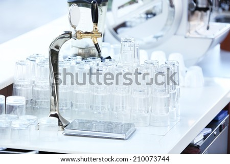 Stacks of clean glasses, indoors - stock photo