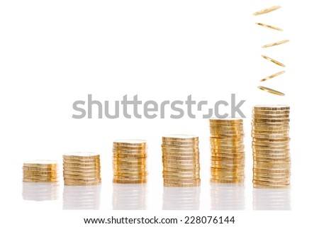 Stacks of coins and falling coins  on a white background. Money growth concept.