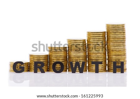 "Stacks of coins and words ""GROWTH"" on a white background"