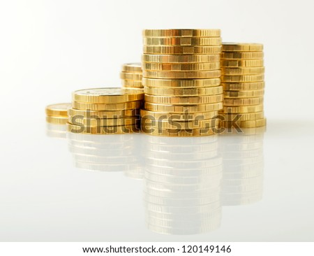 Stacks of coins on a light surface.