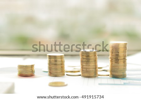 Stacks of coins on banking account in the background,color filter,lens flare
