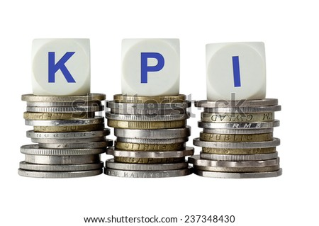 Stacks of coins with the letters KPI isolated on white background  - stock photo