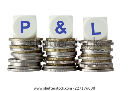 Stacks of coins with the letters P&L isolated on white background  - stock photo