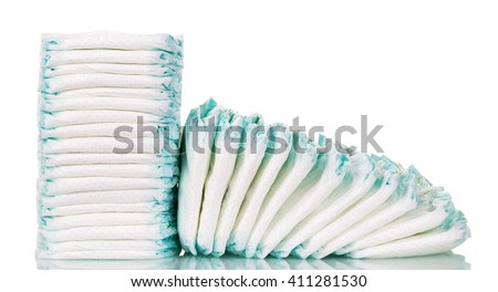 Stacks of diapers for children isolated on white background. - stock photo