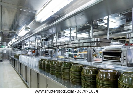 Stacks of Empty Serving Dishes in Commercial Kitchen - stock photo