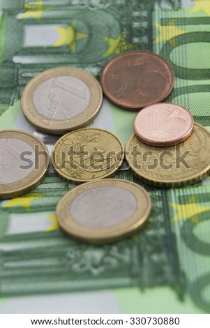 Stacks of euro coins and banknotes - stock photo