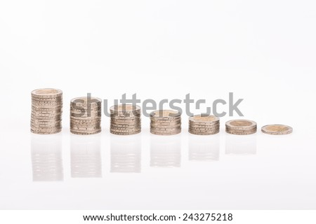 Stacks of Euro coins - conceptual shot for economic downturn in the Euro zone - stock photo