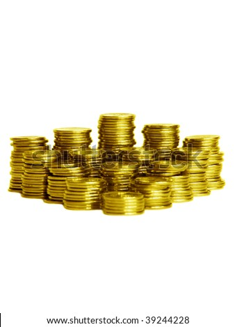 Stacks of gold coins, isolated over white background. Shallow DOF. - stock photo