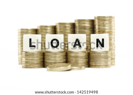 Stacks of Gold Coins with the word LOAN on a White Background - stock photo