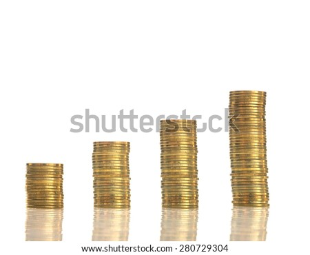 stacks of golden coins on white background - stock photo