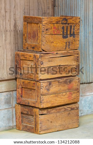 Stacks of grunge and old wood boxes - stock photo
