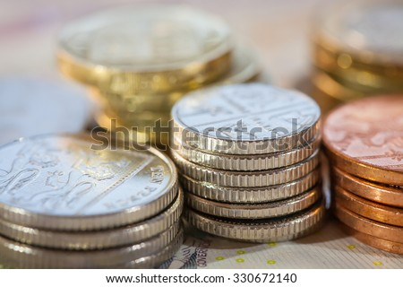 Stacks of money, UK coins of one, five, ten and twenty pence and pound coins - stock photo