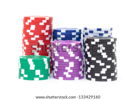 Stacks of Multicolored Poker Chips, closeup on white background