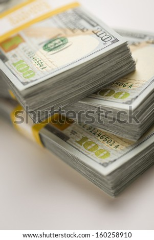 Stacks of Newly Designed One Hundred Dollar Bills with Selective Focus. - stock photo