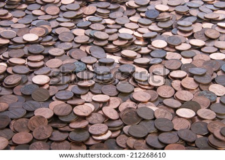 stacks of old dirty pennies. bronze and copper pennies. - stock photo