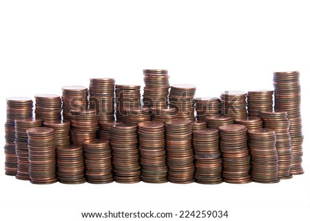 stacks of old dirty pennies. bronze and copper pennies isolated on a white background - stock photo