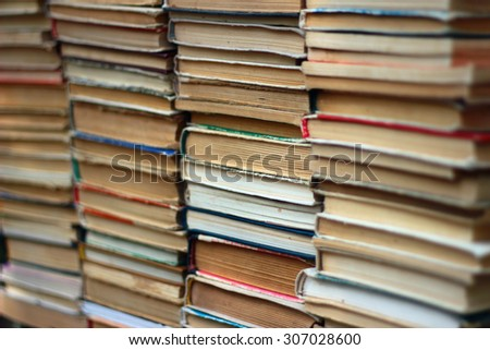 Stacks of old hardback and paperback books - stock photo