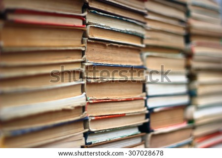 Stacks of old hardback and paperback books. Background image - stock photo
