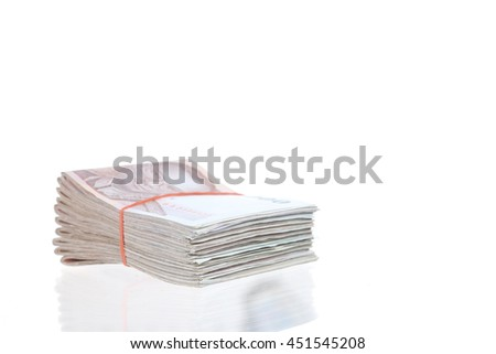 Stacks of one thousand baht banknotes - stock photo