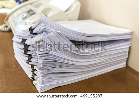 Stacks of paper in office