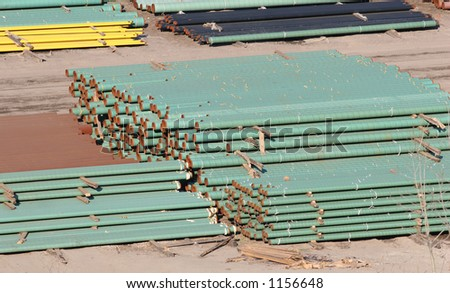 Stacks of pipes. - stock photo