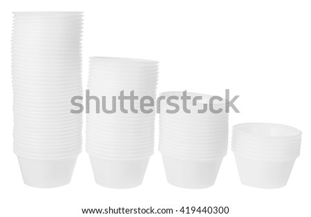 Stacks of Plastic Containers on White Background - stock photo