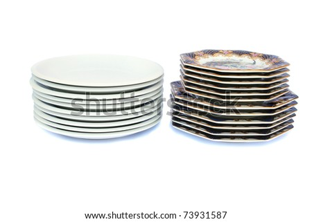 Stacks of plates isolated on white background.