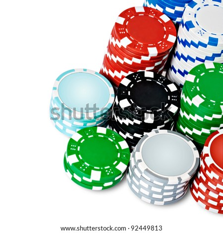 Stacks of poker chips including red, black, gray white, green and blue on a white background