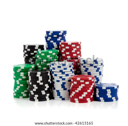 Stacks of poker chips including red, black, white, green and blue on a white background - stock photo