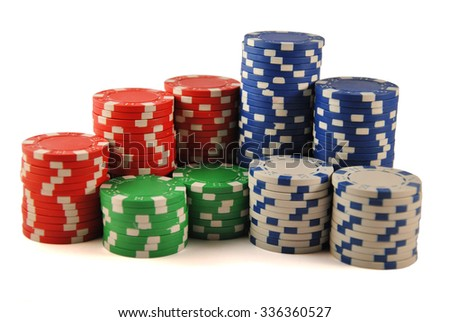 Stacks of poker chips including red white green and blue on a white background