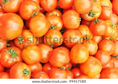 stacks of red tomatoes