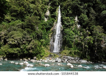 Stacks of rocks at Fantail Falls at the trailhead for Mt. Brewster at the Haast Pass road on New Zealand�s South Island. - stock photo