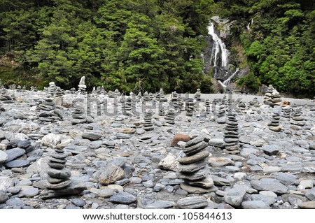 Stacks of rocks at Fantail Falls at the trailhead for Mt. Brewster at the Haast Pass road on New Zealand�s South Island.