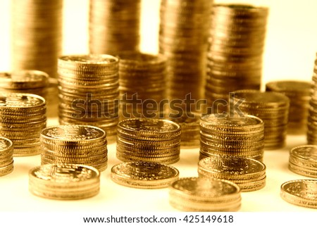 Stacks of rupee coins against white background - stock photo