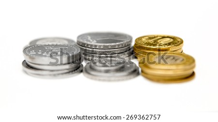 Stacks of Russian, Georgian and Armenian coins on a white background