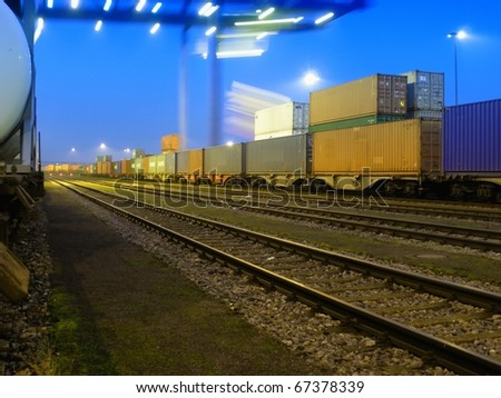 Stacks of shipping containers at night - stock photo