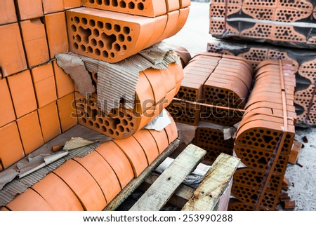 Stacks of silicate bricks with rounded edges - stock photo