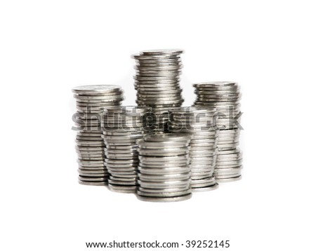 Stacks of silver coins, isolated over white background. Shallow DOF.