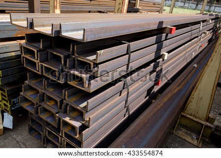 Stacks of stainless steel bars and rails in an iron deposit - stock photo